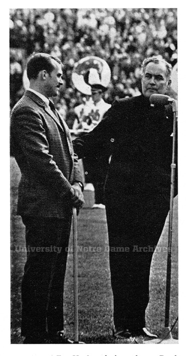 University President Rev. Theodore Hesburgh, C.S.C. introduces Bleier at halftime of the 1969 football game against USC. Bleier had just returned from the Vietnam War, where he had been injured.