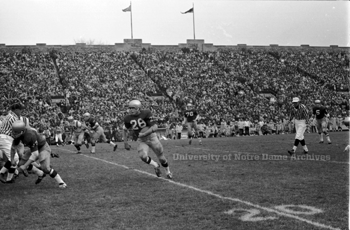Rocky Bleier, '68 runs with the ball during the Irish's game against Navy in 1967.
