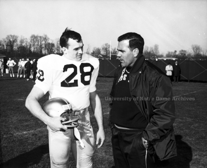 Head coach Ara Parseghian talks with captain Rocky Bleier on the sidelines at practice in 1967.