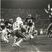 The Irish offensive line rushes the Miami quarterback during the 1984 game at Notre Dame Stadium.